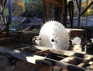 Sun shining on mill saw at R M Smith Lumber McAlisterville